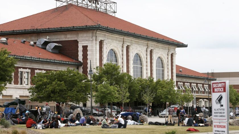 People camp in front of the historic Rio Grande train station just south of the Road Home shelter in Salt Lake City.