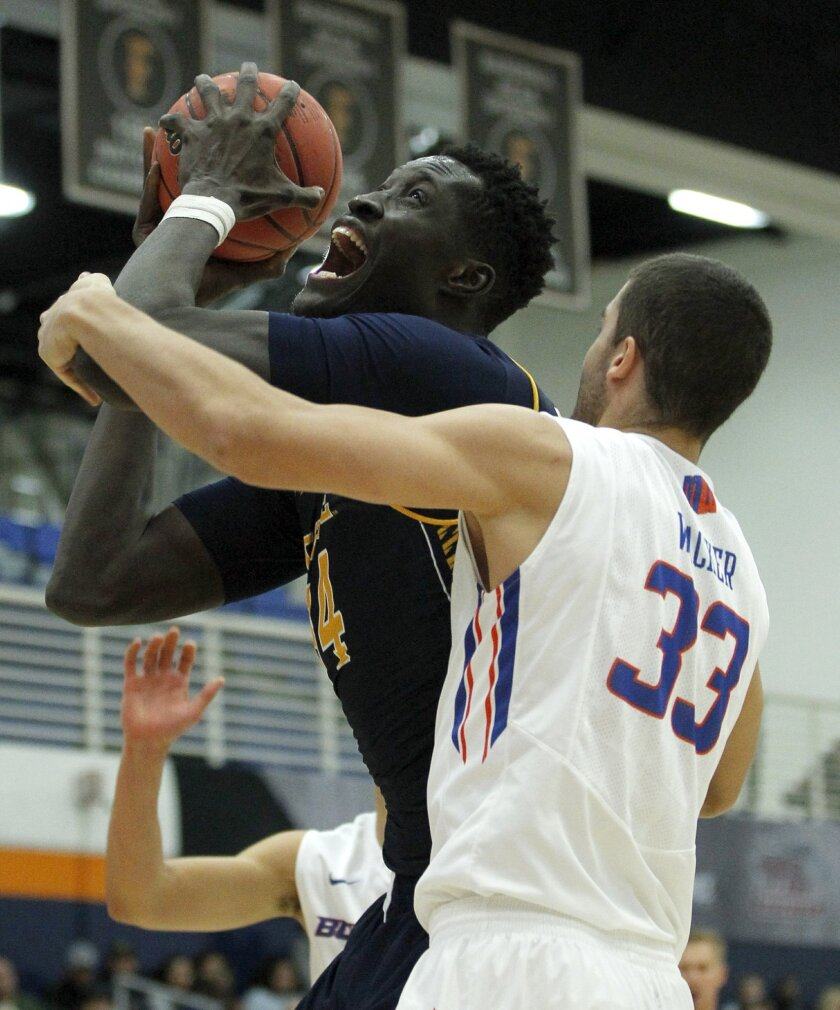 UC Irvine center Mamadou Ndiaye (34) goes up against Boise State forward David Wacker (33) during the first half of an NCAA college basketball game in the quarterfinals of the Wooden Legacy tournament, in Fullerton, Calif., Thursday, Nov. 26, 2015. (AP Photo/Alex Gallardo)