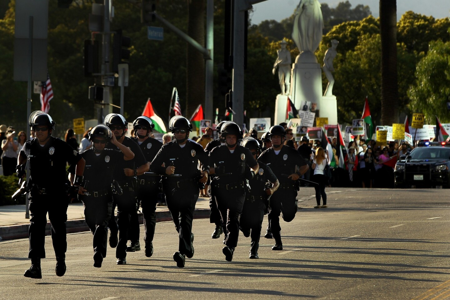 Police in riot gear respond to clashes at a pro-Israel rally at the federal building in Westwood on Sunday.