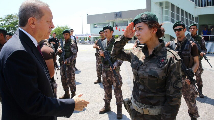 Turkey President Recep Tayyip Erdogan greets a member of the special police forces in Ankara on Friday.