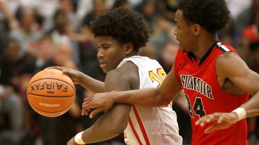 Fairfax guard Ethan Anderson drives to the basket against Westchester guard Jordan Brinson during a Western League game this season.