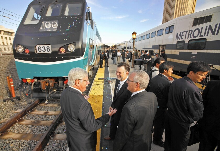 In this photo from 2010, Arthur T. Leahy, left, Metro's chief executive, chats with other transit officials at Union Station after Metrolink unveiled its new state-of-the-art cab and passenger rail cars equipped with collision-absorption technology.