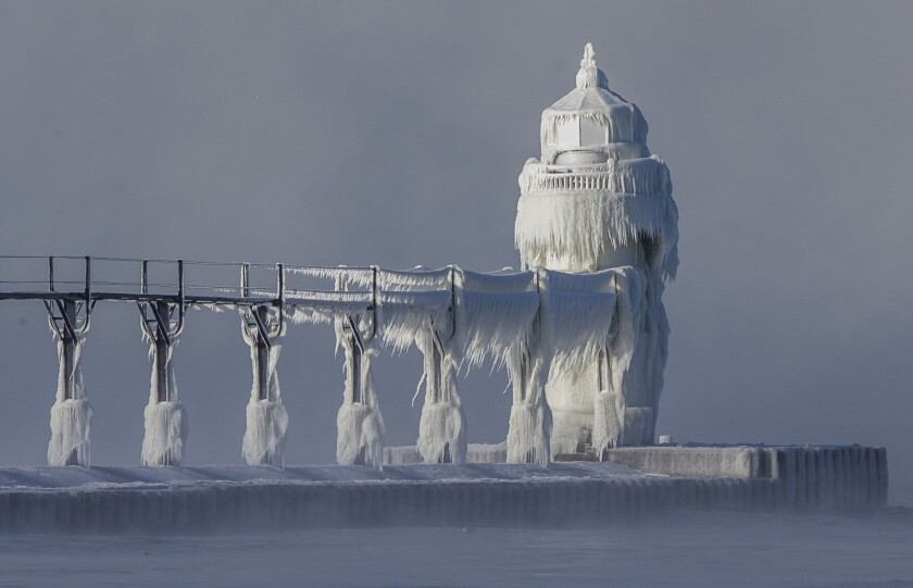 Extreme cold conditions cause ice accretions to cover the St. Joseph lighthouse and pier, on the southeastern shoreline of Lake Michigan.