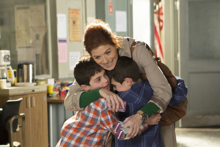 Laura (Debra Messing) is a detective and the mother of twin boys (Charlie, left, and Vincent Reina).