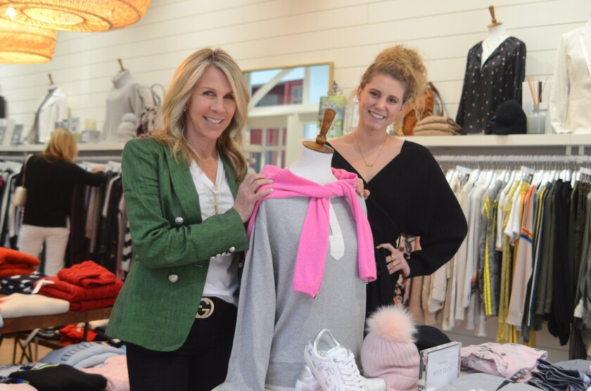 Patty Brutten, left, co-owner of Sea Biscuit and the Del Mar Plaza, at Sea Biscuit with store manager Hailey Hofer.