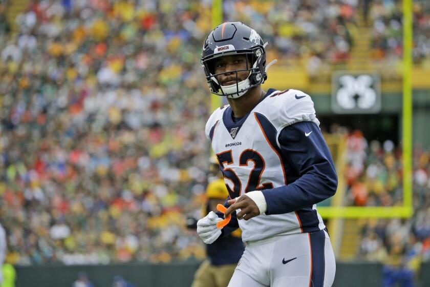 Denver Broncos linebacker Justin Hollins takes up his position.
