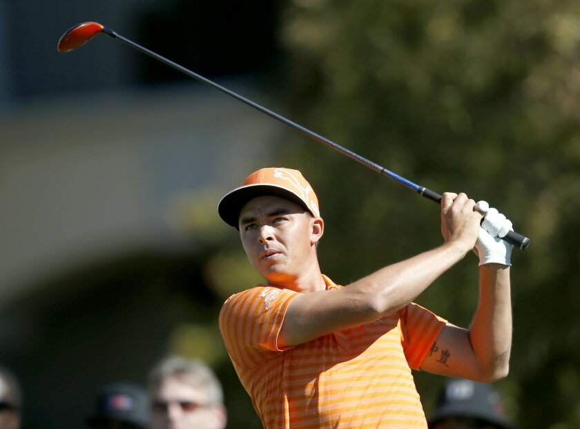 Rickie Fowler tees off on the fifth hole during the final round of the Phoenix Open golf tournament, Sunday, Feb. 7, 2016, in Scottsdale, Ariz. (AP Photo/Rick Scuteri)