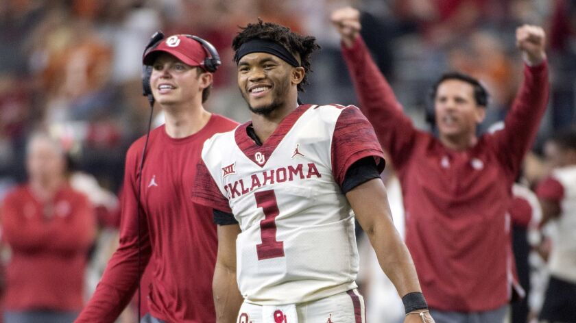 FILE - In this Dec. 1, 2018, file photo, Oklahoma quarterback Kyler Murray (1) celebrates on the sid