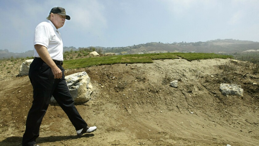 Donald Trump takes an unfinished pathway at the Trump National Golf Club in Rancho Palos Verdes in 2005.