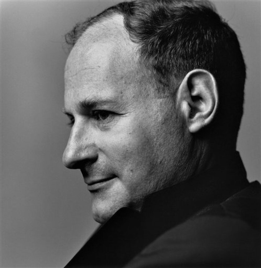 In this 1960s image released by the Irving Penn Studio, photographer Irving Penn is shown. Penn, whose photographs revealed a taste for stark simplicity whether he was shooting celebrity portraits, fashion, still life or remote places of the world, died Wednesday, Oct. 7, 2009, at his Manhattan home. He was 92. (AP Photo/Irving Penn Studio, Inc., Bert Stern)