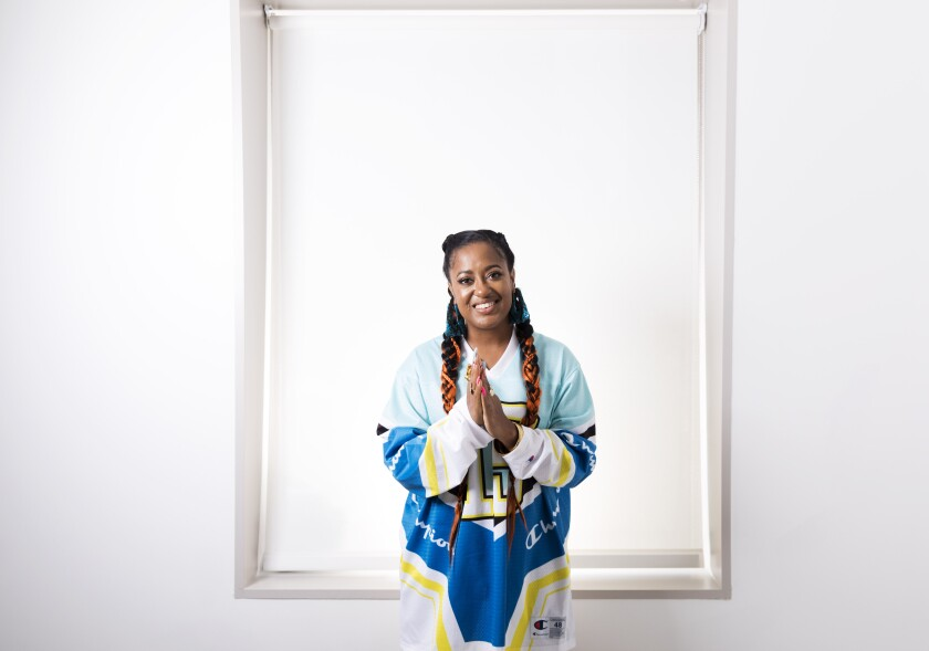 """FILE - This Aug. 22, 2019 photo shows Rapsody posing for a portrait in New York. Rapsody's """"Pray Momma Don't Cry"""" is one of four songs featured on """"I Can't Breath/Music for the Movement,"""" a four-song album that is a joint venture between Disney Music Group and The Undefeated, ESPN's platform for exploring the intersections of race, sports and culture. Rapsody is hoping the album can unite people. (Photo by Brian Ach/Invision/AP, File)"""