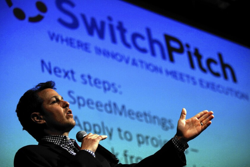 SwitchPitch founder Michael Goldstein addresses the crowd during the event at UCLA in May. Boeing Co., Warner Bros. and Experian were among companies that pitched projects to start-ups.
