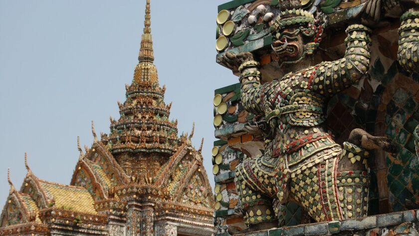 Wat Arun, the Temple of the Dawn, is one of Bangkok's most famous landmarks. Signs outside ask visitors to wear modest clothing.