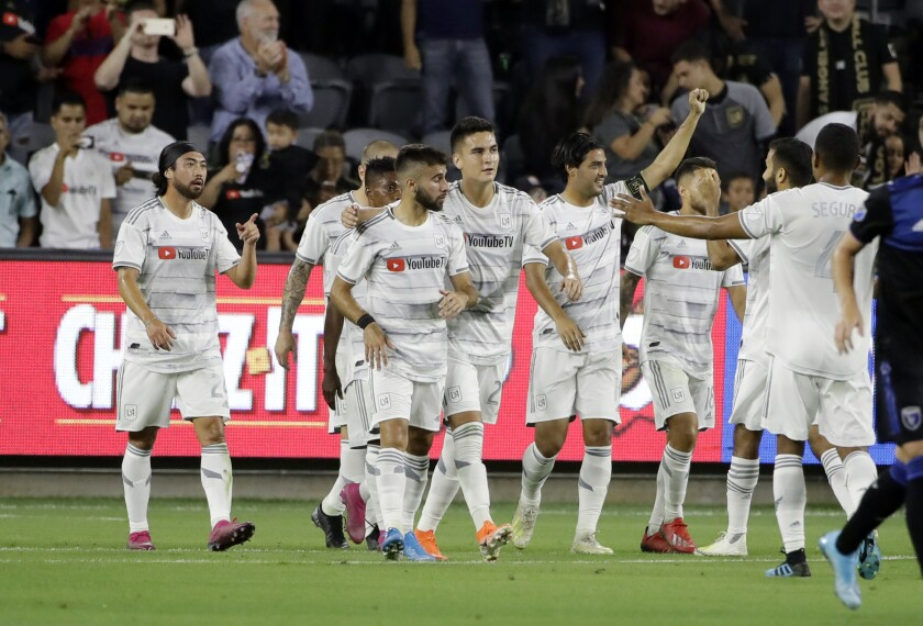 LAFC forward Carlos Vela, with arm raised, celebrates with teammates after scoring on a penalty kick against the San Jose Earthquakes during the first half on Wednesday in San Jose.