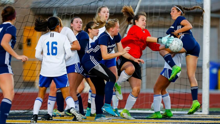 Eastlake goalkeeper Gloriana Hinojosa makes a stop in the first half of the Titans' win over Steele Canyon.