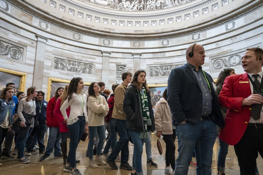 Tourists are arrive for springtime visits as crowds fill the U.S. Capitol, in Washington, Wednesday, March 11, 2020. (AP Photo/J. Scott Applewhite)