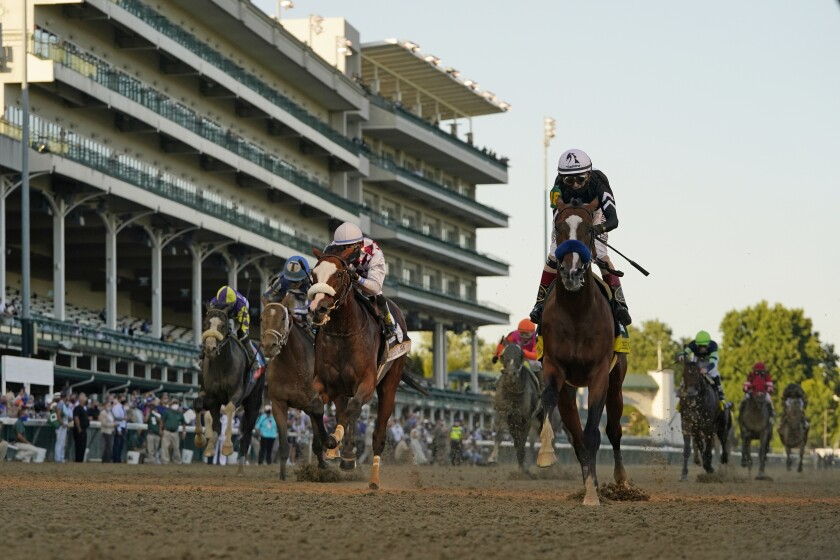 Jockey John Velazquez riding Authentic, right, crosses the finish line to win the 146th running of the Kentucky Derby at Churchill Downs, Saturday, Sept. 5, 2020, in Louisville, Ky. (AP Photo/Jeff Roberson)