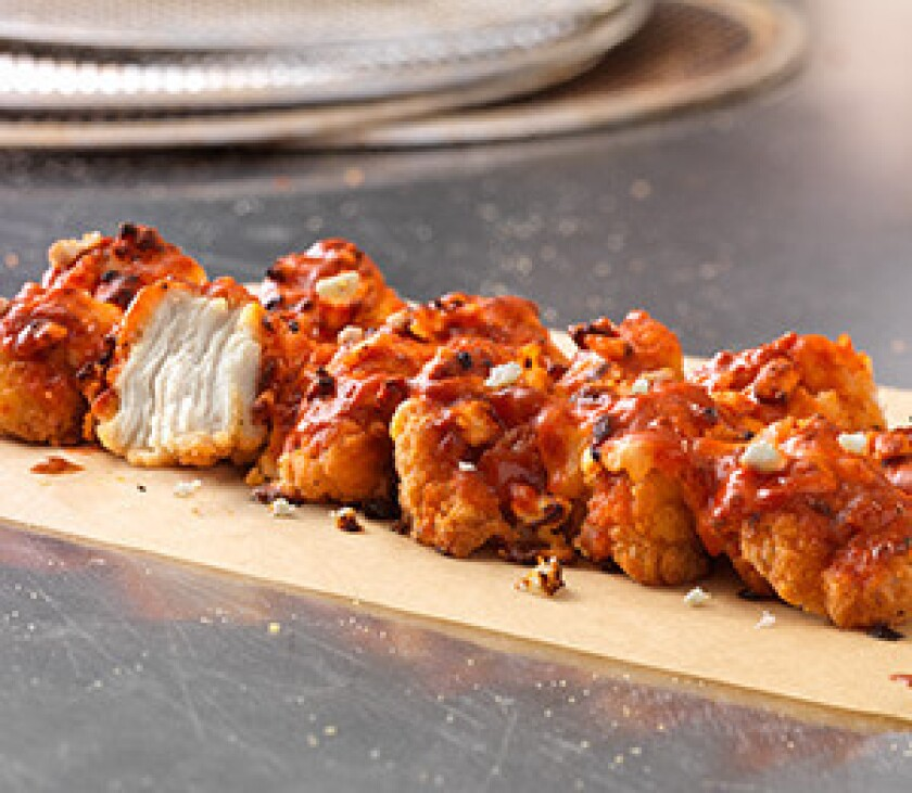 The new Specialty Chicken dish from Dominos. It's fried chicken nuggets with sauce, toppings and cheese.