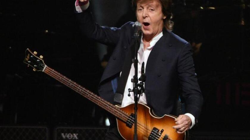 FILE - In this Oct. 22, 2015, file photo, Paul McCartney performs at First Niagara Center, in Buffalo, N.Y. Goldenvoice announced Tuesday, May 3, 2016, that the Rolling Stones, Bob Dylan, McCartney, Neil Young, Roger Waters and the Who will perform during a three-day concert at the desert grounds where the annual Coachella music festival is held. (AP Photo/Gary Wiepert, File) (/ The Associated Press)