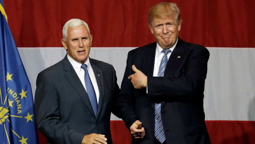 President Trump and Vice President Mike Pence at a campaign rally in 2016. Now Trump has tapped Pence to head U.S. efforts to combat the novel coronavirus COVID-19.