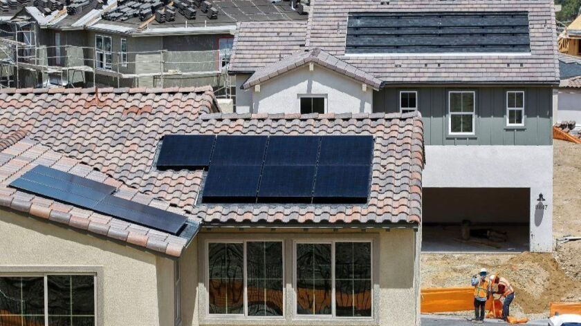 Solar panels are installed on the roofs of some of the newly built homes at the Weston housing development in Santee, Calif.