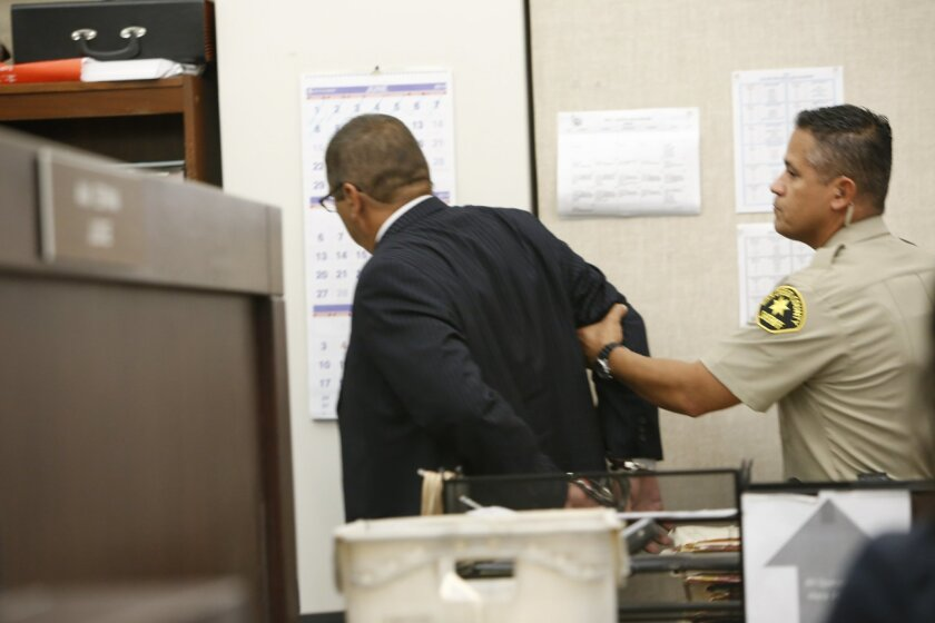 Former Sweetwater Superintendent Jesus Gandara is taken from the courtroom in handcuffs to begin serving his sentence.