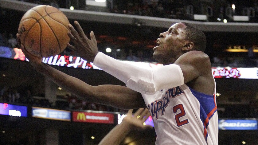 Clippers point guard Darren Collison goes up for a shot during a game against the Boston Celtics in January. Keeping Collison in the fold is Doc Rivers' top priority this offseason.