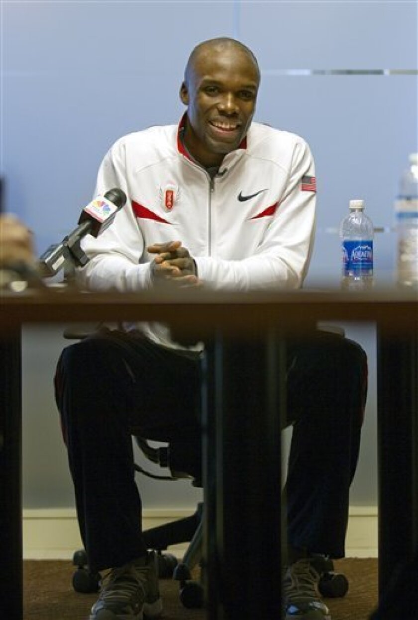 Olympic champion LaShawn Merritt speaks to the media after winning his appeal against an IOC rule banning him from the Olympic games Thursday, Oct. 6, 2011, in Atlanta. Merritt has been cleared to defend his 400-meter title in London next year after serving a suspension for using a banned substance found in a male-enhancement product. (AP Photo/David Goldman)