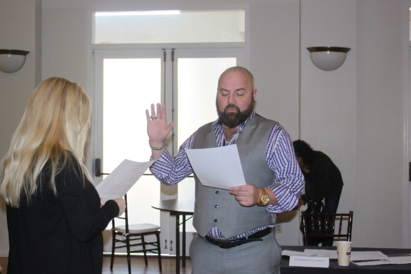 New member Christophe Cevasco (right), who was not present for the November swearing-in ceremony, is sworn in by LJVMA executive director Sheila Fortune.