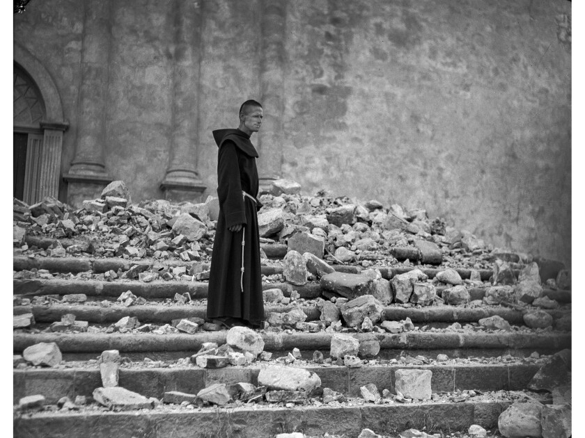 June 29, 1925: Brother Michael Lamm O.F.M., one of the Franciscan friars, stands on the steps of the