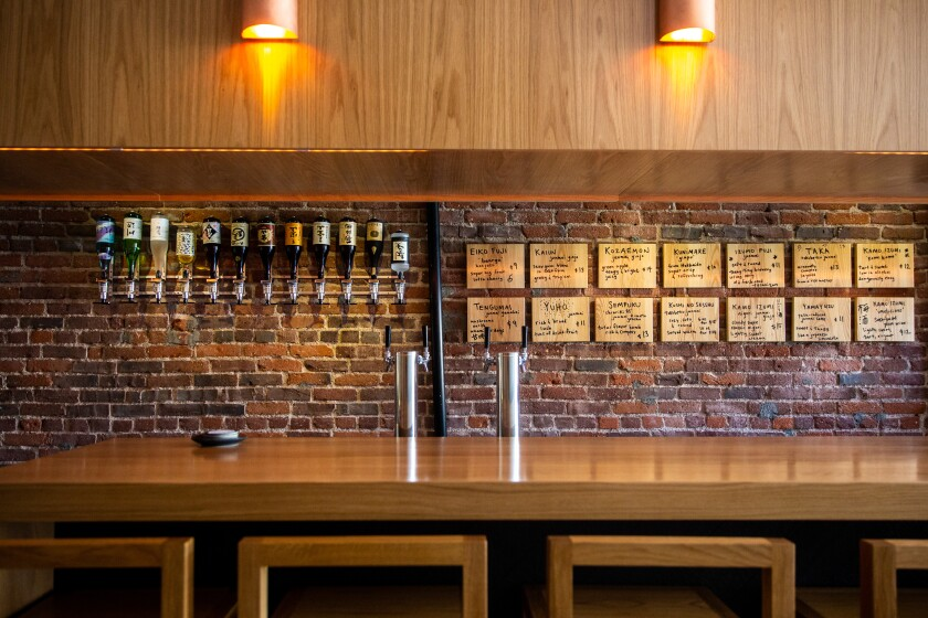 The Shochu pour line, and the bar at Ototo, a sake bar in Echo Park.