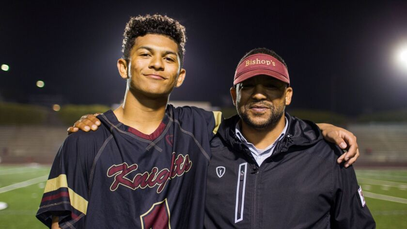 Isaiah Dawson meets up with father Brian Dawson after a recent Bishop's win over La Jolla in which I