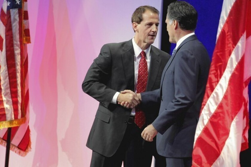 Americans for Prosperity President Tim Phillips shakes hands with Mitt Romney during a summit in Washington. AFP is on track to spend $180 million in the 2012 cycle.