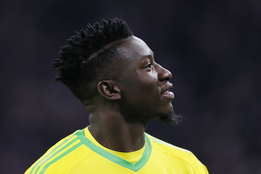 Ajax goalkeeper Andre Onana looks up during the first leg, round of sixteen, Champions League soccer match between Ajax and Real Madrid at the Johan Cruyff ArenA in Amsterdam, Netherlands, Wednesday Feb. 13, 2019. European Soccer Union UEFA has suspended Onana for 12 months after he tested positive for a banned diuretic. (AP Photo/Peter Dejong)