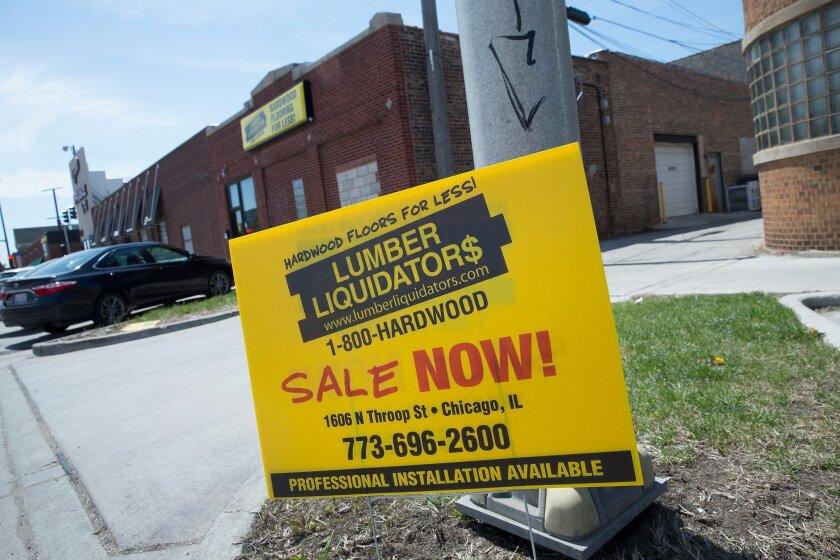 Lumber Liquidators stops sales of Chinese-made flooring