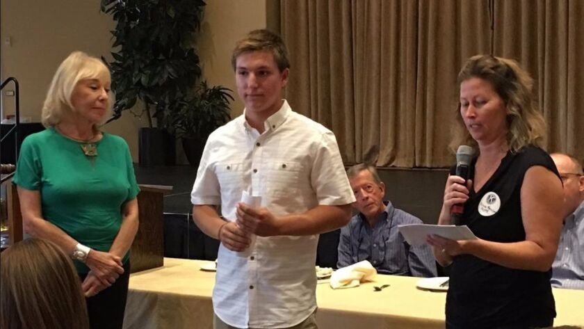At its November meeting, Kiwanis Club of La Jolla presents Mason Matalon (center) with a grant to build a home through Project Mercy for a family in need in Tijuana.