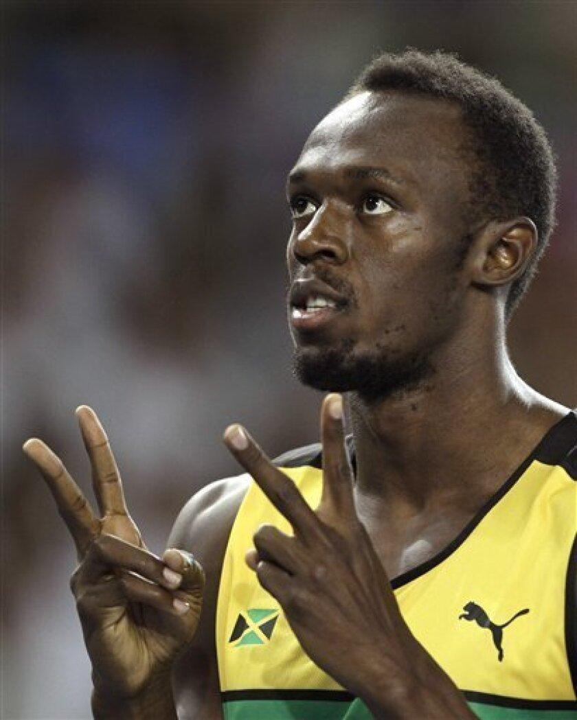 Jamaica's Usain Bolt gestures before a Men's 200m semifinal at the World Athletics Championships in Daegu, South Korea, Friday, Sept. 2, 2011. (AP Photo/Matt Dunham)