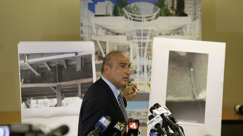 Mark Zabaneh, executive director of the Transbay Joint Powers Authority, points to a photograph showing a cracked steel beam found in the Salesforce Transit Center during a news conference Wednesday.