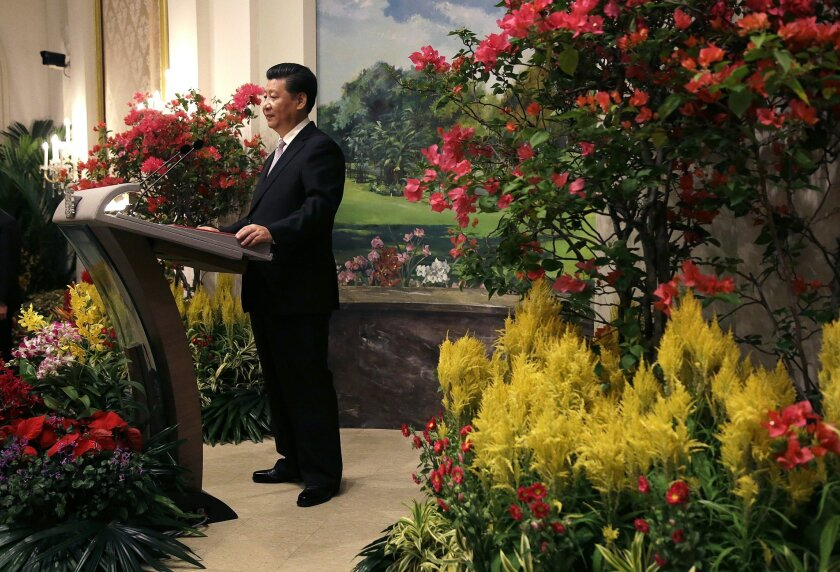 Chinese President Xi Jinping delivers a speech during a state banquet held at the Istana or presidential palace as part of his official visit to Singapore on Friday, Nov. 6, 2015. (AP Photo/Wong Maye-E, Pool)