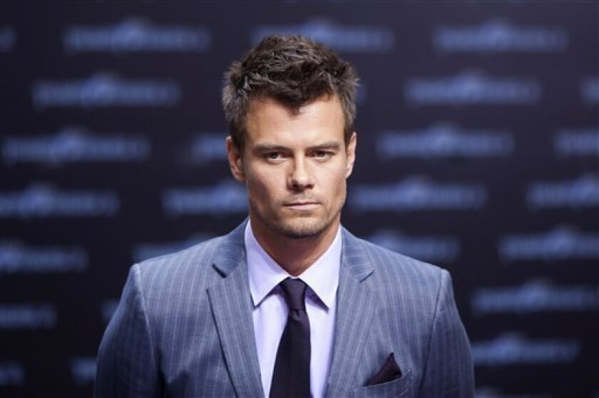 In this June 25, 2011 photo, actor Josh Duhamel attends the German premier of the movie Transformer 3 in Berlin. The Hollywood actor is returning to his hometown of Minot over the Labor Day weekend to raise awareness and money for victims of a devastating flood that swamped the North Dakota city this summer. (AP Photo/Markus Schreiber)