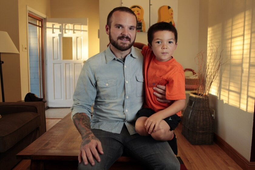 Nate Appleman with his son Oliver, 7, who was diagnosed with Kawasaki disease when he was 2 years old.