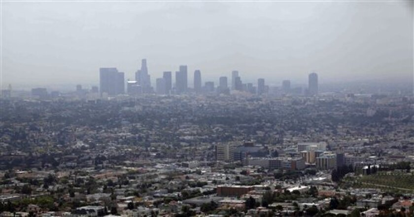 Smog covers downtown Los Angeles in this file photo from 2009.