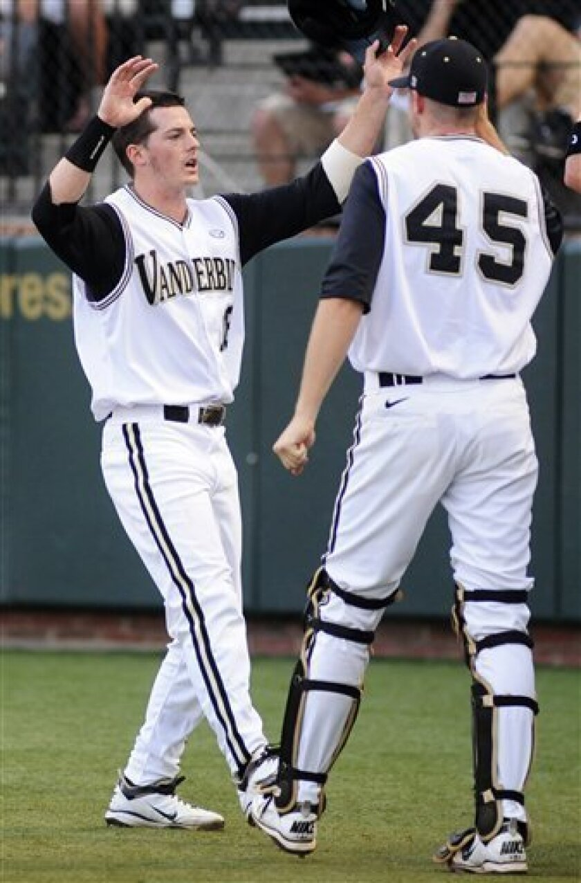 Vanderbilt's Mike Yastrzemski, left, is congratulated by teammate Drew Fann (45) after scoring against Oregon State during the first inning in Game 1 of an NCAA Super Regionals college baseball tournament, Friday, June 10, 2011, in Nashville, Tenn. (AP Photo/Mike Strasinger)