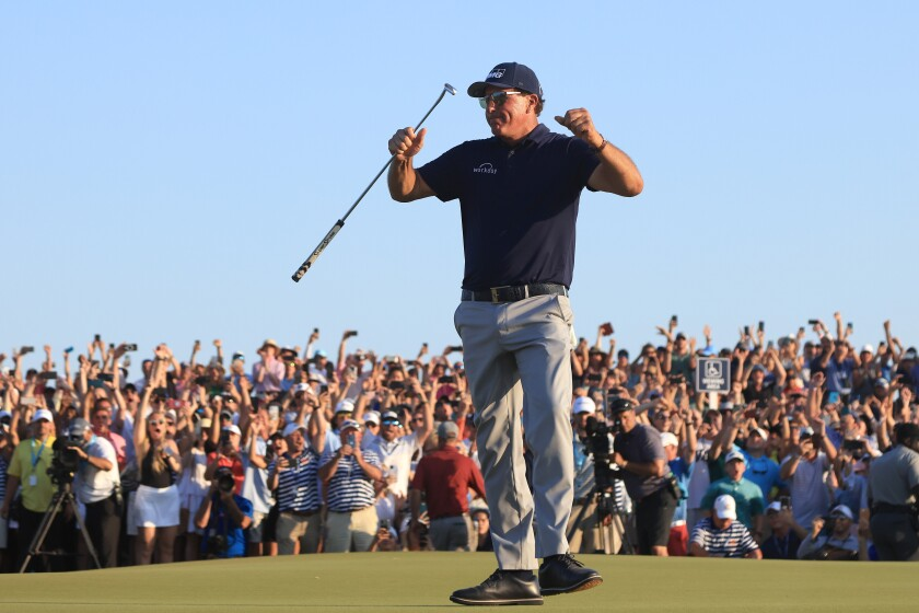 Phil Mickelson of the United States celebrates on the 18th green after winning Sunday's PGA Championship.
