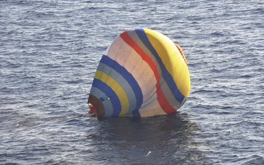 This Wednesday, Jan. 1, 2013 photo released by  Japan's 11th Regional Coast Guard shows a hot-air balloon in which the Coast Guard says a  Chinese cook took a ride, in waters near the East China Sea islands called Senkaku by Japan and Diaoyu by China. Xu Shuaijun, 35, crashed Wednesday after hittin