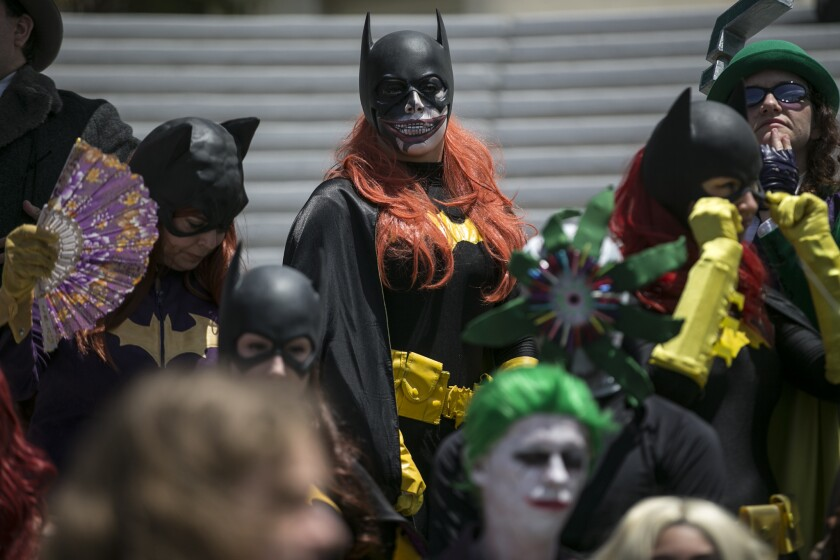 DC world cosplayers gather for a photo shoot on the last day of Comic-Con 2016 at the San Diego Convention Center.