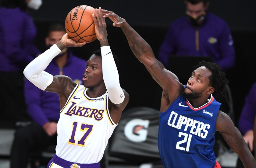 Clippers Patrick Beverley gets a piece of Lakers Dennis Schroder as he goes up for a shot.