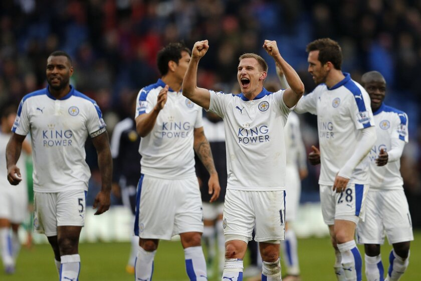 Leicester players celebrate after winning the English Premier League soccer match between Crystal Palace and Leicester City at Selhurst Park stadium in London, Saturday, March 19, 2016.(AP Photo/Frank Augstein)