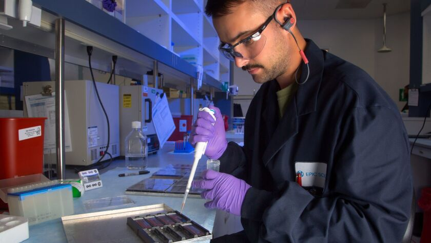 At Epic Science in La Jolla, Taylor Kress, lab technician prepares white blood cells so that can be