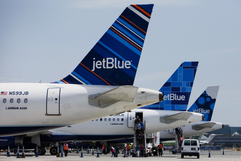 JetBlue planes at Long Beach Airport in 2013. The New York-based airline plans to move its hub to LAX.